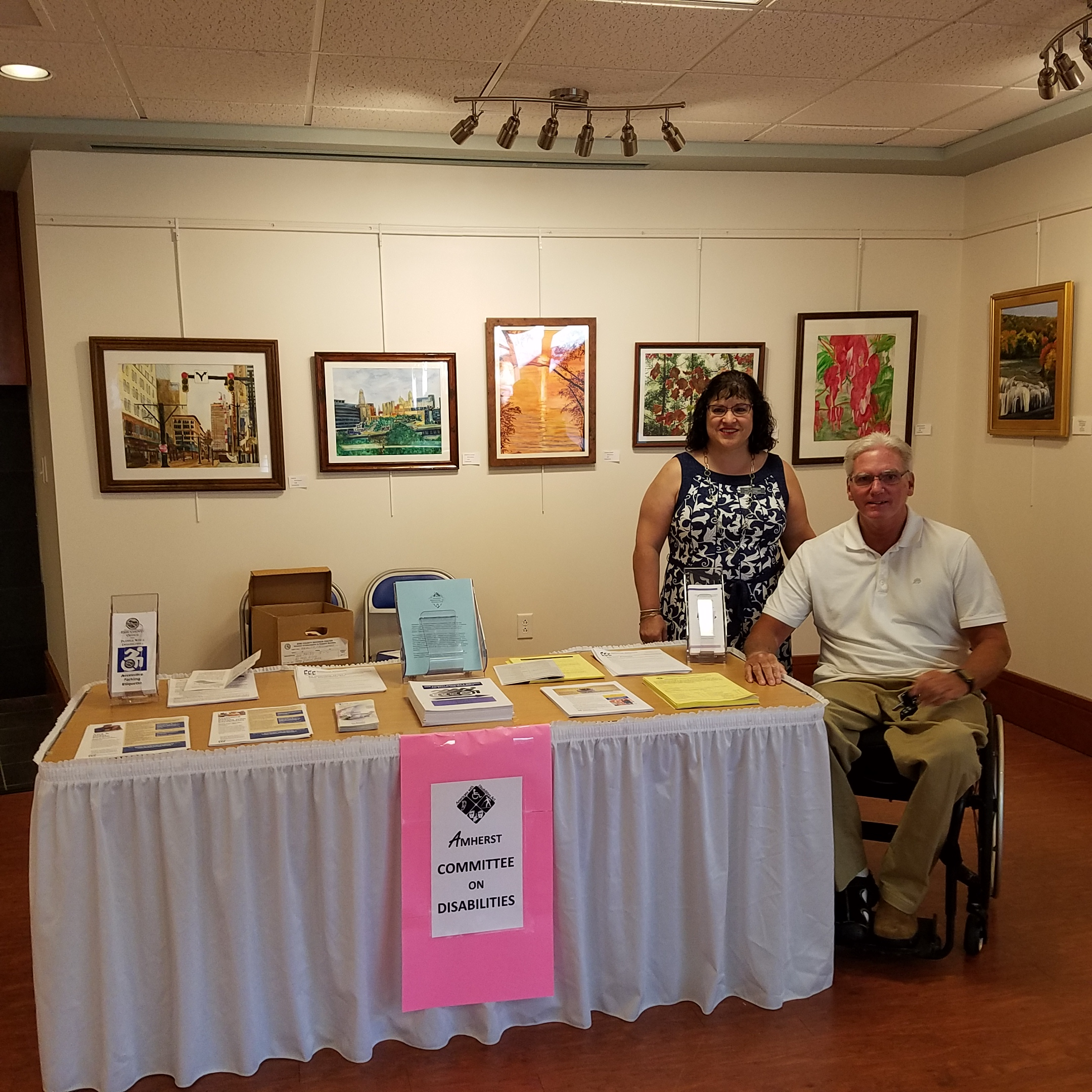 Pictured at the Family Health Fair held on August 4, 2019 at the Amherst Senior Center are Luci Miranda, Committee Member, and Thomas Roetzer, Committee Co-Chair.  The Committee had a table at the Fair, and provided various leaflets with information pertinent to persons with disabilities.