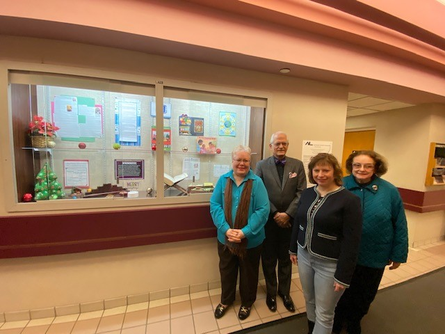 Members of the Amherst Community  Diversity Commission with Exhibit  at  Audubon  Public Library.